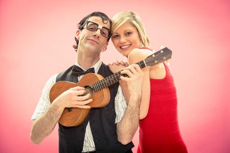 Nerd man boyfriend play ukulele love song for valentine day Stok Fotoğraf