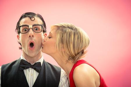 Nerd man boyfriend kissed by his girlfriend portrait love for valentine day
