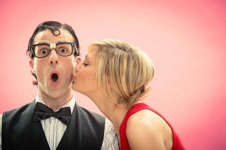 funny glasses: Nerd man boyfriend kissed by his girlfriend portrait love for valentine day