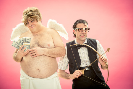 cupid man: Nerd man with glasses with money buy love bow and arrow from cupid for valentine day