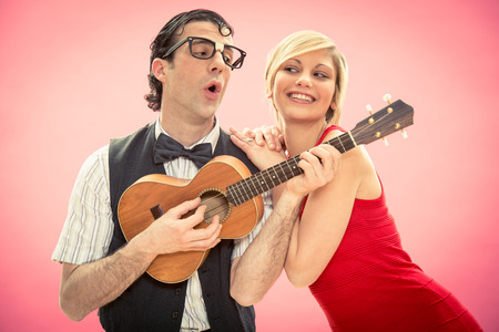 nerd: Nerd man boyfriend play ukulele love song for valentine day Stock Photo