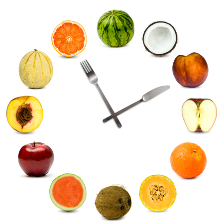 clock made of different fruit composition set isolated on white
