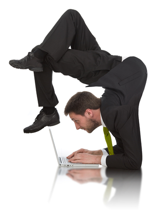 contortion: businessman work contortion with laptop isolated on white Stock Photo
