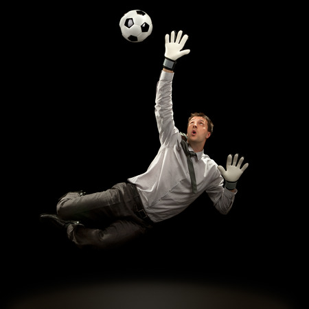 businessman goalkeeper save a goal on black background Stockfoto