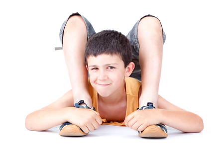contortionist: flexible boy kid smile isolated on white Stock Photo