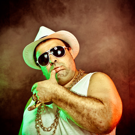 undershirt: italian funny mafia boss rapper with undershirt and sunglasses on smoky background