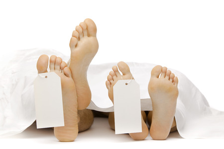 autopsy: dead body feet with card autopsy isolated on white Stock Photo