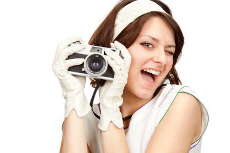 adult 80s: beautiful vintage girl take photograph with old camera isolated on white