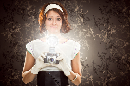 80s adult: beautiful vintage girl take photograph with old camera on tapestry background