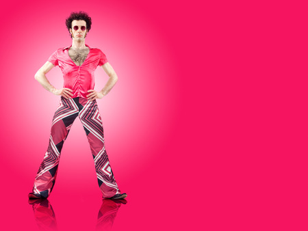 1970s vintage man stand with pink background