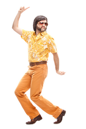 70s disco: 1970s vintage man with orange dress dance isolated on white