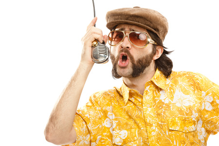 1970s vintage show man sing with hawaiian shirt and microphone isolated on white