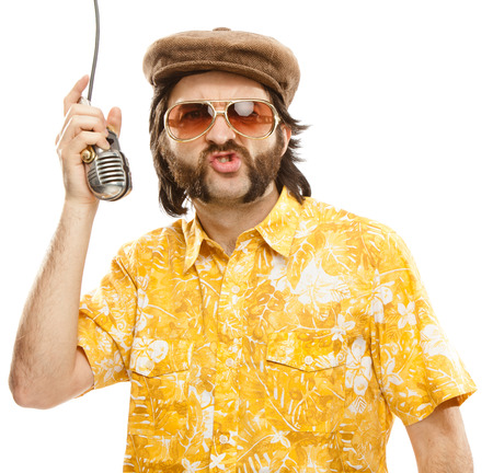 hawaiian shirt: 1970s vintage show man sing with hawaiian shirt and microphone isolated on white