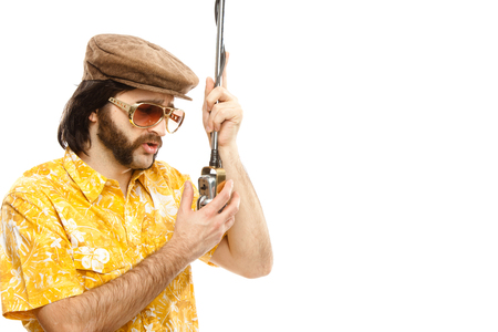 sideburns: 1970s vintage show man sing with hawaiian shirt and microphone isolated on white