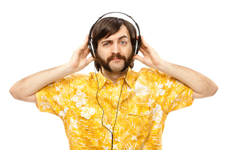 sideburns: 1970s vintage show man sing with hawaiian shirt and headphones isolated on white Stock Photo