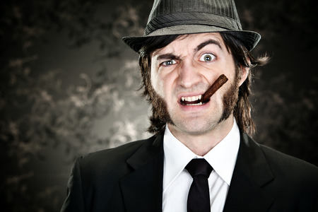 sideburns: elegant boss man with sideburns and cigar on black backround Stock Photo