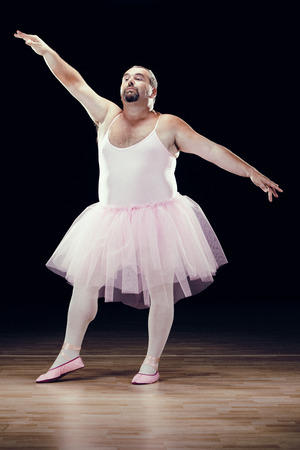 balletic: funny fat classical dancer on black background