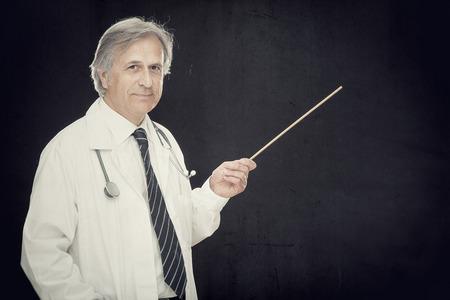 smartness: caucasian professor or scientist point stick on blackboard with positive keywords