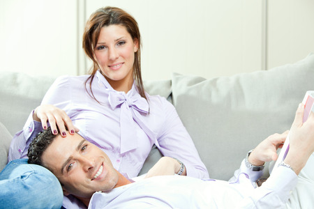 couple on couch: young happy couple relax on couch at home
