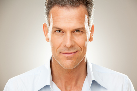 stylish hair: handsome man with shirt portrait isolated on grey