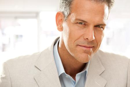 handsome smiling businessman gaze portrait at office