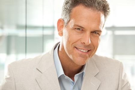 gaze: handsome smiling businessman gaze portrait at office