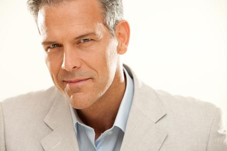 gaze: handsome smiling businessman gaze portrait isolated on white Stock Photo