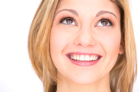 perfect teeth: young blonde smiling woman portrait with perfect teeth isolated on white