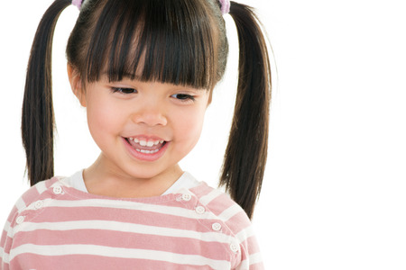 pigtail: asian smiling little girl with pigtail isolated on white