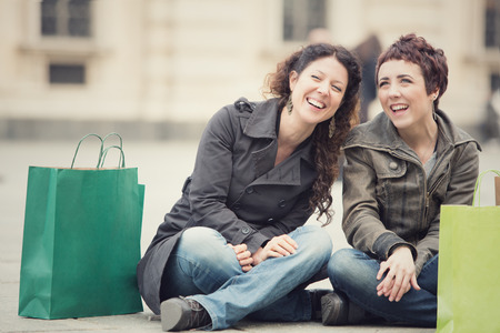 black lesbian: smiling happy women shop together in cityscape Stock Photo