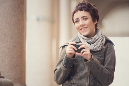 short hair: short hair smiling woman walk in cityscape