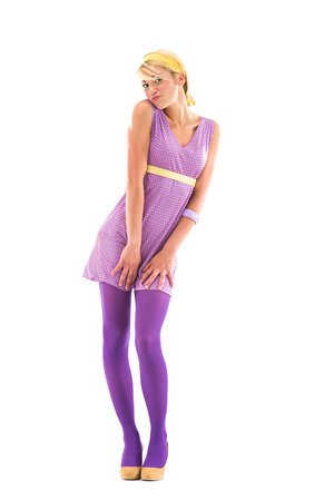 70s: vintage 70s blonde model with violet dress isolated on white