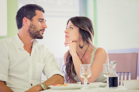 romantic man: Young romantic brunette couple talking  at restaurant Stock Photo