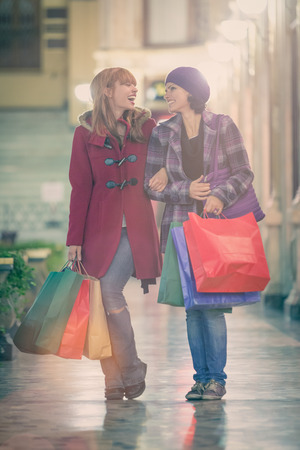 two young woman shop during christmas time in a cityscape Stock Photo