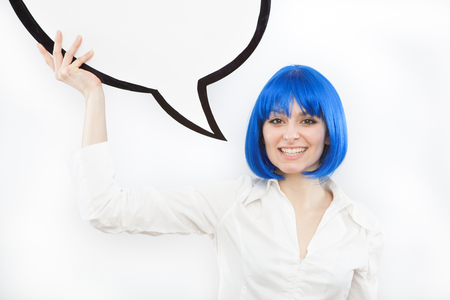 brunette: pretty young brunette caucasian woman smiling with comic baloon and blue wig on white background