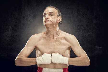 pugilist: funny old boxer portrait show muscle isolted on black