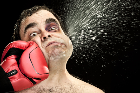 Black eye wound boxer spit due big punch hit portrait