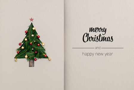 Merry Christmas and happy new year greetings in vertical top view cardboard with natural eco decorated christmas tree pine.Ecology concept.Xmas winter holiday season social media card background