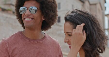 Romantic couple smiling caressing feeling free and happy to the main square in rural town of Assisi.Close shot.Friends italian trip in Umbria.4k slow motion Stock Photo - 124983108