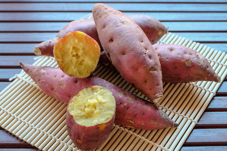 Sweet potato (Japanese potato) on brown table.