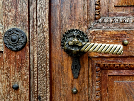 Ancient  door handle on brown old wooden door