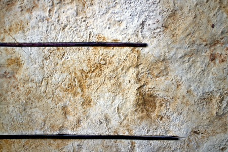 embedded: Two thin iron embedded in the stone wall