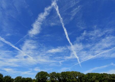 Chemtrails on blue sky Stock fotó