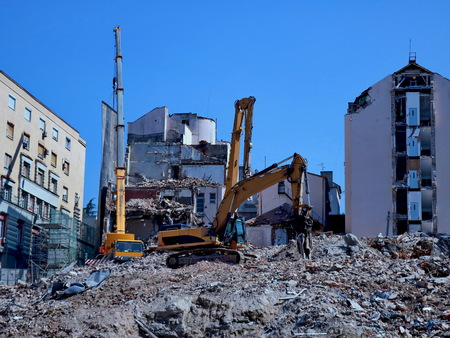 Excavation machinery and building demolition