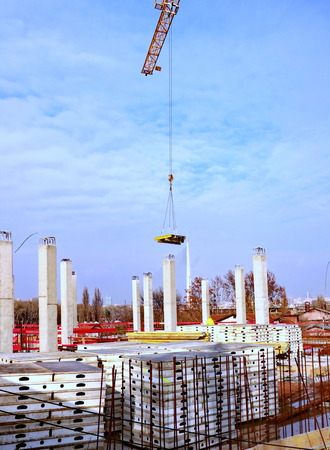 New building is being constructed with use of tower crane