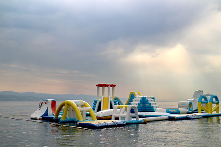 Rubber barriers at sea for children's play Standard-Bild - 101435252