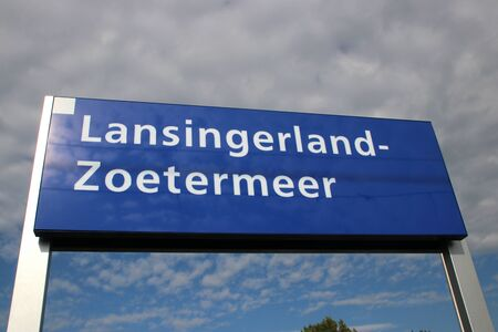 Name sign of new railroad station Lansingerland Zoetermeer in the Netherlands 版權商用圖片 - 130817032
