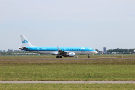 PH-EXC KLM Cityhopper Embraer ERJ-190STD Aircraft landing at the Polderbaan 36L-18R at the Amsterdam Schiphol airport in the Netherlands