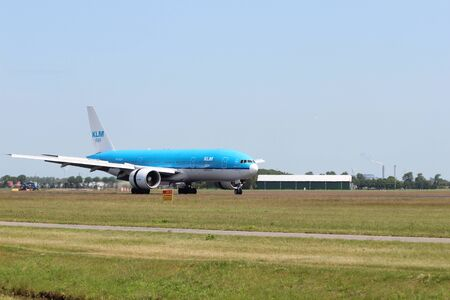 PH-BQM KLM Royal Dutch Airlines Boeing 777-206 Aircraft landing at the Polderbaan 36L-18R at the Amsterdam Schiphol airport in the Netherlands