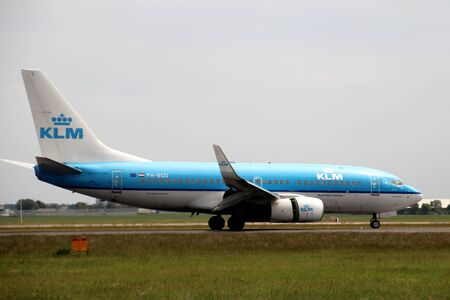 PH-BGU KLM Royal Dutch Airlines Boeing 737 Aircraft landing at the Polderbaan 36L-18R at the Amsterdam Schiphol airport in the Netherlands Editorial